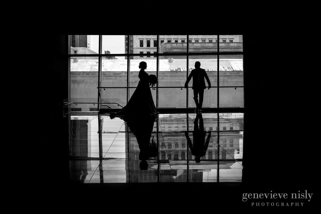 Justin and Kate in silhouetted against the windows of the Westin during their wedding in Downtown Cleveland.