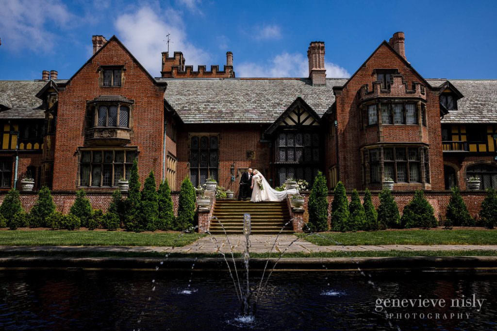 Laura and Anthony on the west terrace of Stan Hywet Hall and Gardens during their wedding in Akron, Ohio. Photo by Genevieve Nisly Photography.